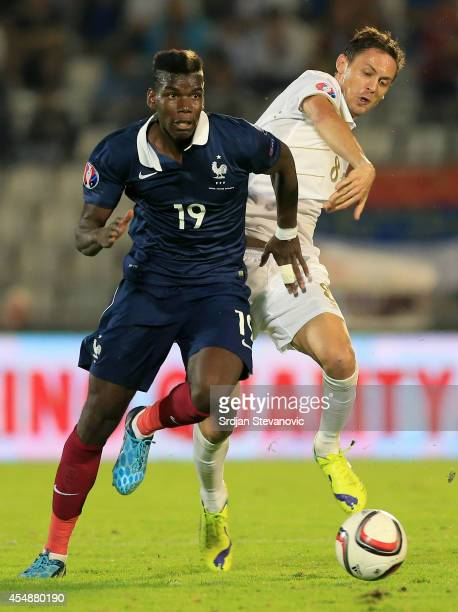 Paul Pogba of France is challenged by Nemanja Matic of Serbia during the International friendly match between Serbia and France at the Stadium JNA on...