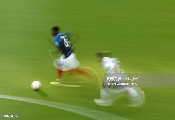 Paul Pogba of France is chased by Nicolas Tagliafico of Argentina during the 2018 FIFA World Cup Russia Round of 16 match between France and...