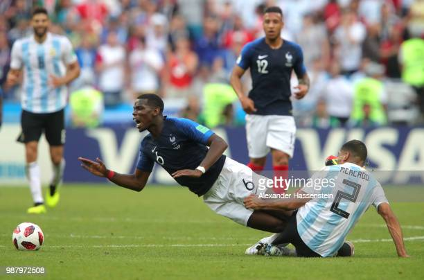 Paul Pogba of France is fouled by Gabriel Mercado of Argentina during the 2018 FIFA World Cup Russia Round of 16 match between France and Argentina...