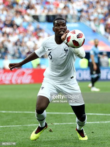 Paul Pogba of France looks to control the ball during the 2018 FIFA World Cup Russia Quarter Final match between Uruguay and France at Nizhny...