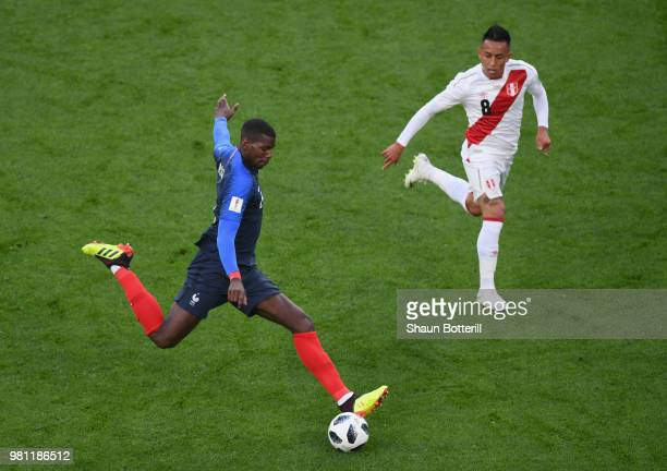 Paul Pogba of France passes the ball as Christian Cueva of Peruduring the 2018 FIFA World Cup Russia group C match between France and Peru at...