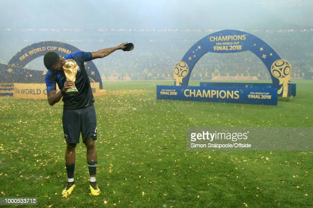 Paul Pogba of France performs a dab with the trophy after the 2018 FIFA World Cup Russia Final between France and Croatia at the Luzhniki Stadium on...
