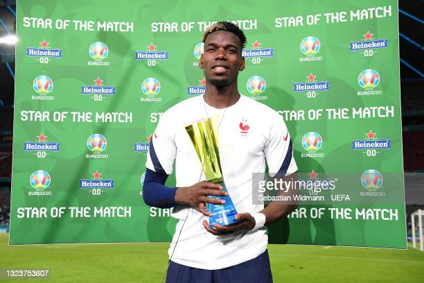 """Paul Pogba of France poses for a photograph with their Heineken """"Star of the Match"""" award after the UEFA Euro 2020 Championship Group F match between..."""