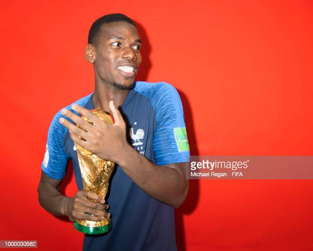 Paul Pogba of France poses with the Champions World Cup trophy after the 2018 FIFA World Cup Russia Final between France and Croatia at Luzhniki...