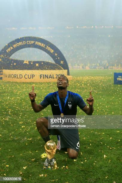 Paul Pogba of France poses with the trophy after the 2018 FIFA World Cup Russia Final between France and Croatia at the Luzhniki Stadium on July 15...
