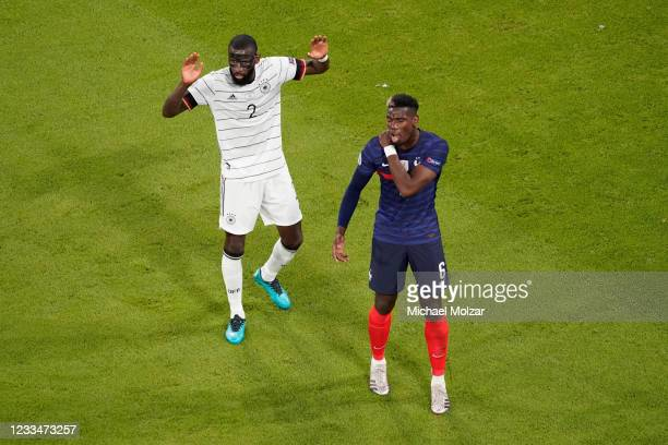 Paul Pogba of France reacts after an attack by Antonio Ruediger of Germany during the UEFA Euro 2020 group F match between France and Germany at...
