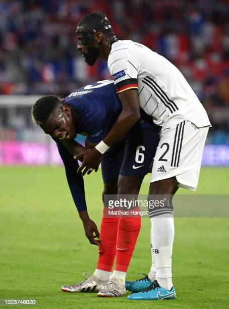 Paul Pogba of France reacts after being fouled by Antonio Ruediger of Germany during the UEFA Euro 2020 Championship Group F match between France and...