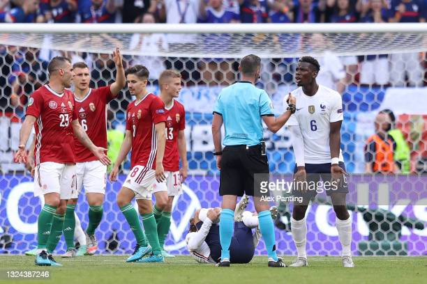 Paul Pogba of France reacts towards Match Referee, Michael Oliver during the UEFA Euro 2020 Championship Group F match between Hungary and France at...