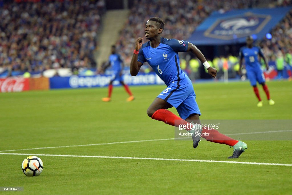 Paul Pogba of France runs with ball during the FIFA 2018 World Cup Qualifier between France and The Netherlands at Stade de France on August 31, 2017 in Paris, France .