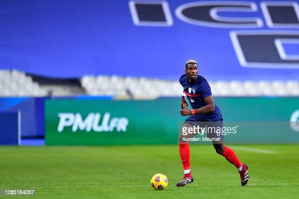 Paul Pogba of France runs with the ball during the international friendly match between France and Finland at Stade de France on November 11, 2020 in...