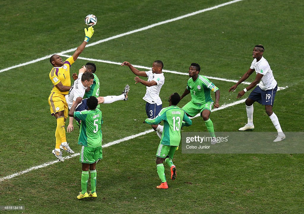 Paul Pogba of France scores his team's first goal on a header past goalkeeper Vincent Enyeama of Nigeria during the 2014 FIFA World Cup Brazil Round of 16 match between France and Nigeria at Estadio Nacional on June 30, 2014 in Brasilia, Brazil.