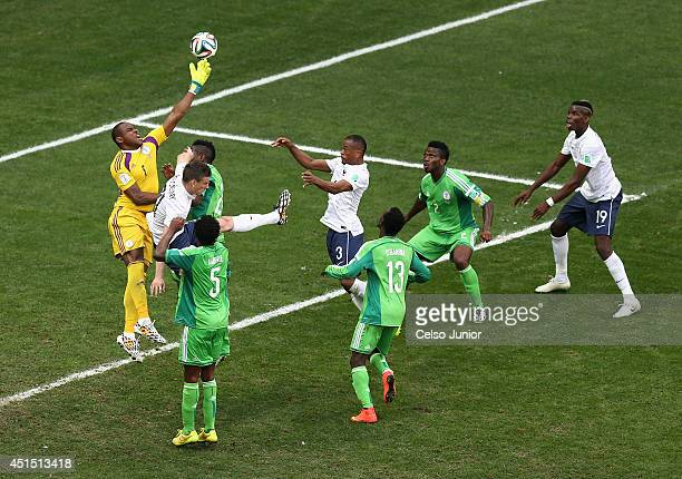 Paul Pogba of France scores his team's first goal on a header past goalkeeper Vincent Enyeama of Nigeria during the 2014 FIFA World Cup Brazil Round...