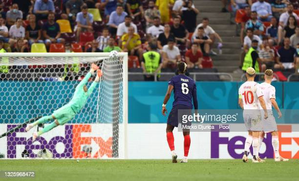 Paul Pogba of France scores their side's third goal past Yann Sommer of Switzerland during the UEFA Euro 2020 Championship Round of 16 match between...