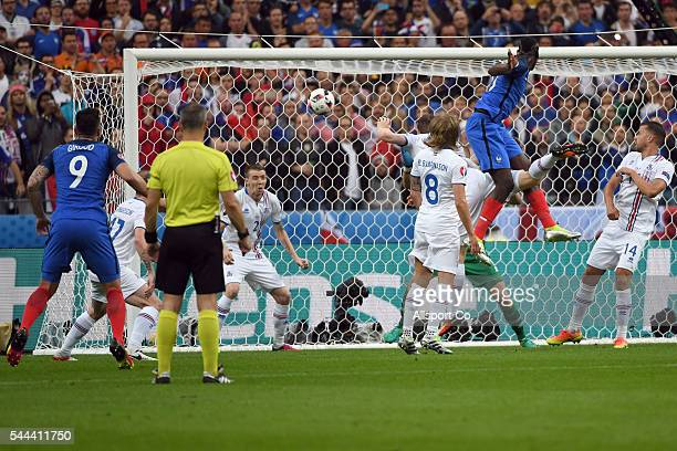 Paul Pogba of France scores with a header during the UEFA EURO 2016 quarter final match between France and Iceland at Stade de France on July 3 2016...