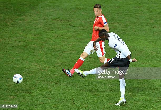 Paul Pogba of France shoots at goal during the UEFA EURO 2016 Group A match between Switzerland and France at Stade PierreMauroy on June 19 2016 in...