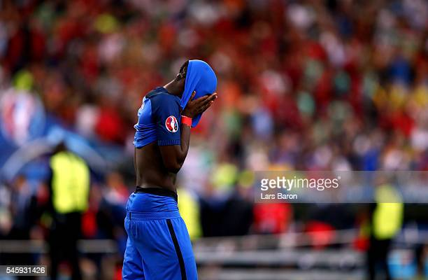 Paul Pogba of France shows his dejection after his team's 0-1 defeat in the UEFA EURO 2016 Final match between Portugal and France at Stade de France...