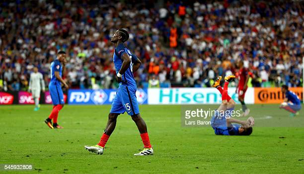 Paul Pogba of France shows his dejection after his team's 01 defeat in the UEFA EURO 2016 Final match between Portugal and France at Stade de France...