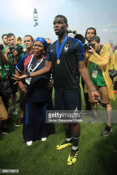 Paul Pogba of France stands with his motherYeo after the 2018 FIFA World Cup Russia Final between France and Croatia at the Luzhniki Stadium on July...