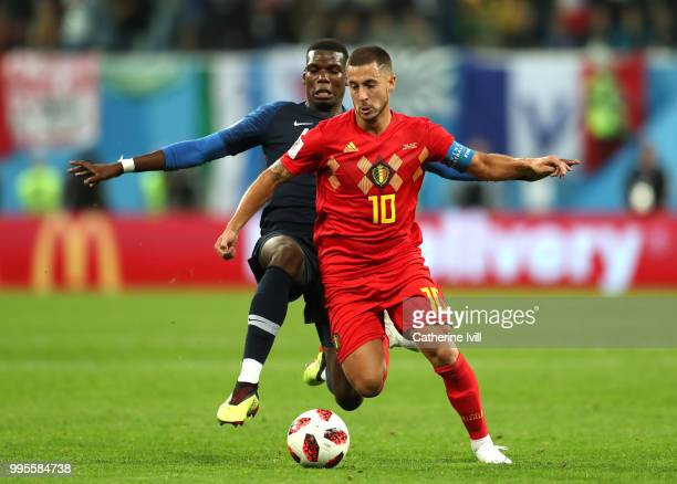 Paul Pogba of France tackles Eden Hazard of Belgium during the 2018 FIFA World Cup Russia Semi Final match between Belgium and France at Saint...