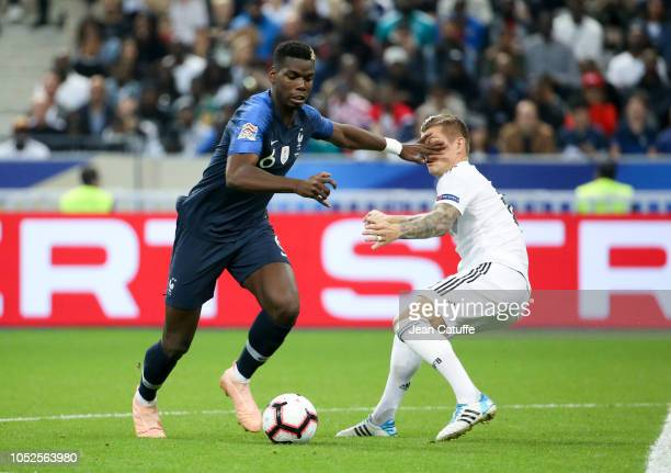 Paul Pogba of France Toni Kroos of Germany during the UEFA Nations League A group one match between France and Germany at Stade de France on October...