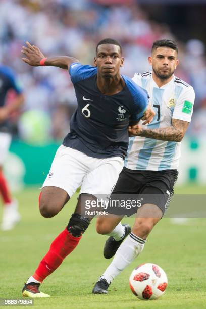 Paul Pogba of France vies Ever Banega of Argentinaduring the 2018 FIFA World Cup Russia Round of 16 match between France and Argentina at Kazan Arena...