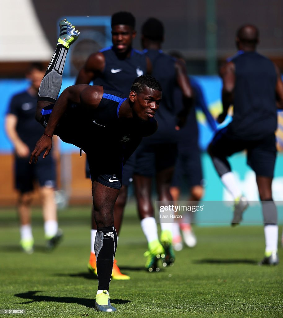 Paul Pogba of France warms up during a France training session ahead of their UEFA Euro 2016 Semi final against Germany on July 6, 2016 in Marseille, France.