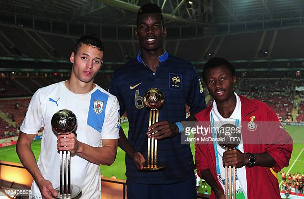 Paul Pogba of France wins the adidas Golden Ball award Nicolas Lopez of Uruguay wins the adidas Silver Ball award and Clifford Aboagye of Ghana wins...
