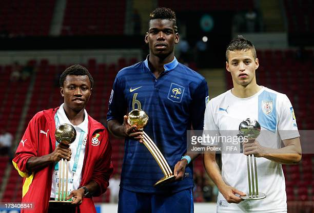 Paul Pogba of France with his adidas Golden Ball award Nicolas Lopez of Uruguay with his adidas Silver Ball award and Clifford Aboagye of Ghana with...