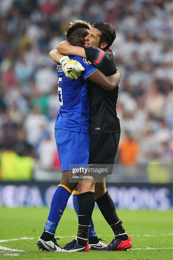 Paul Pogba of Juventus and Gianluigi Buffon of Juventus celebrate following their team's progression to the final during the UEFA Champions League Semi Final, second leg match between Real Madrid and Juventus at Estadio Santiago Bernabeu on May 13, 2015 in Madrid, Spain.