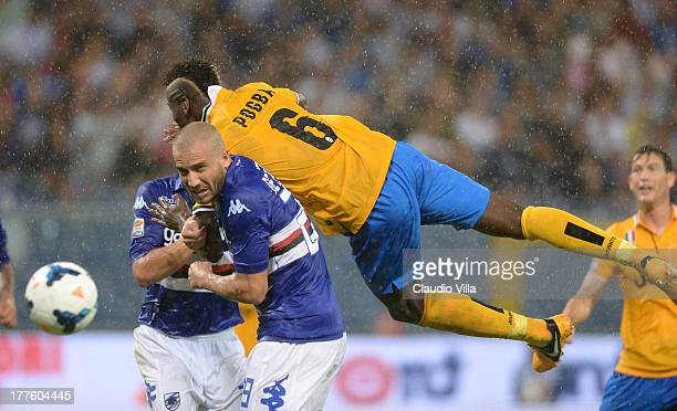 Paul Pogba of Juventus and Lorenzo De Silvestri of UC Sampdoria compete for the ball during the Serie A match between UC Sampdoria and Juventus at...