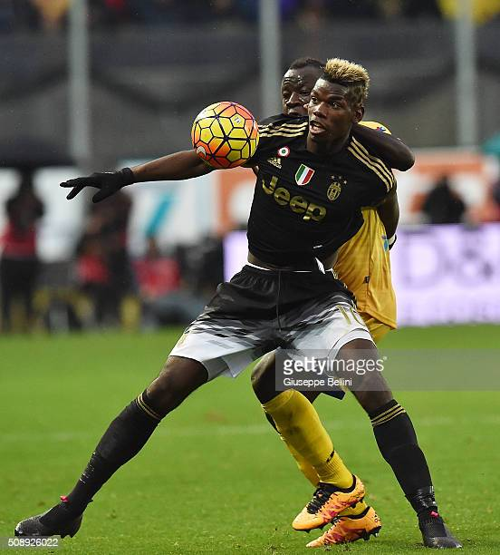 Paul Pogba of Juventus and Raman Chibsah of Frosinone in action during the Serie A match between Frosinone Calcio and Juventus FC at Stadio Matusa on...