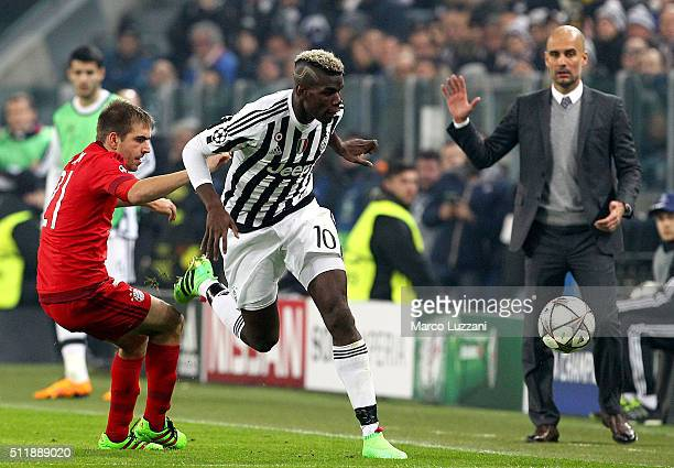 Paul Pogba of Juventus competes for the ball with Philipp Lahm of FC Bayern Muenchen during the UEFA Champions League Round of 16 first leg match...