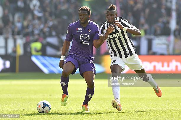 Paul Pogba of Juventus competes with Anderson of ACF Fiorentina during the Serie A match between Juventus and ACF Fiorentina at Juventus Arena on...