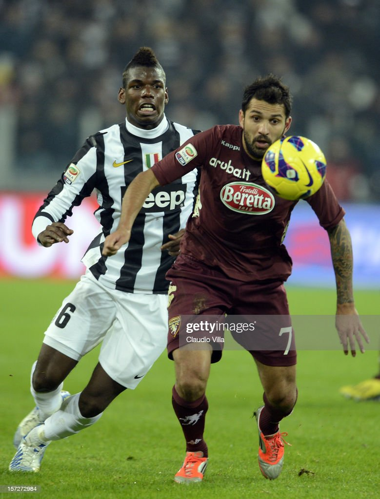 Paul Pogba of Juventus FC (L) and Mario Santana of Torino FC compete for the ball during the Serie A match between Juventus and Torino FC at Juventus Arena on December 1, 2012 in Turin, Italy.