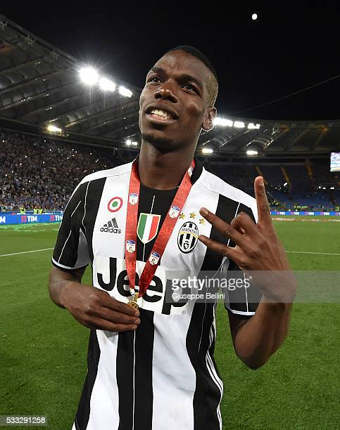 Paul Pogba of Juventus FC celebrates the victory after the TIM Cup match between AC Milan and Juventus FC at Stadio Olimpico on May 21 2016 in Rome...