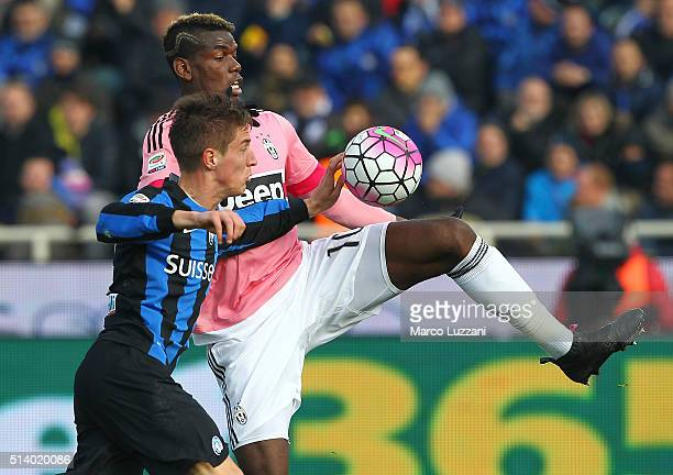 Paul Pogba of Juventus FC competes for the ball with Andrea Conti of Atalanta BC during the Serie A match between Atalanta BC and Juventus FC at...