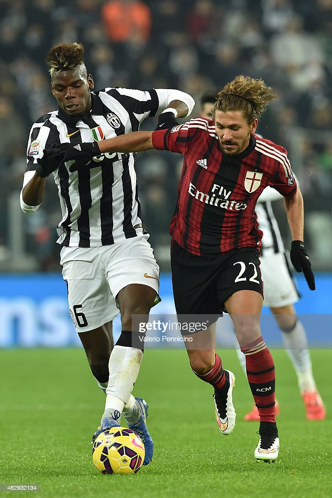 Paul Pogba (L) of Juventus FC competes with Alessio Cerci of AC Milan during the Serie A match between Juventus FC and AC Milan at Juventus Arena on February 7, 2015 in Turin, Italy.