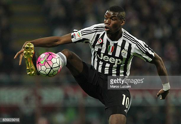 Paul Pogba of Juventus FC controls the ball during the Serie A match between AC Milan and Juventus FC at Stadio Giuseppe Meazza on April 9 2016 in...
