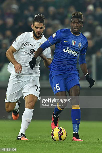 Paul Pogba of Juventus FC in action against Panagiotis Tachtsidis of Hellas Verona FC during the TIM Cup match between Juventus FC and Hellas Verona...