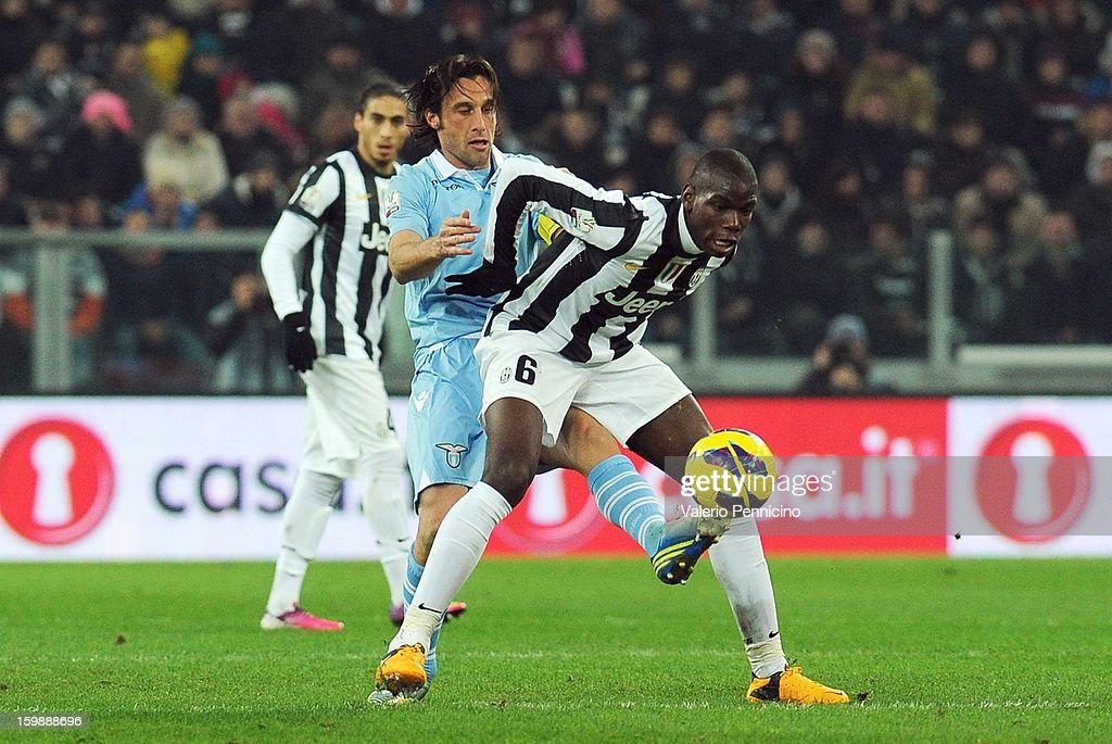 Paul Pogba (R) of Juventus FC is challenged by Stefano Mauri of S.S. Lazio during the TIM cup match between Juventus FC and S.S. Lazio at Juventus Arena on January 22, 2013 in Turin, Italy.