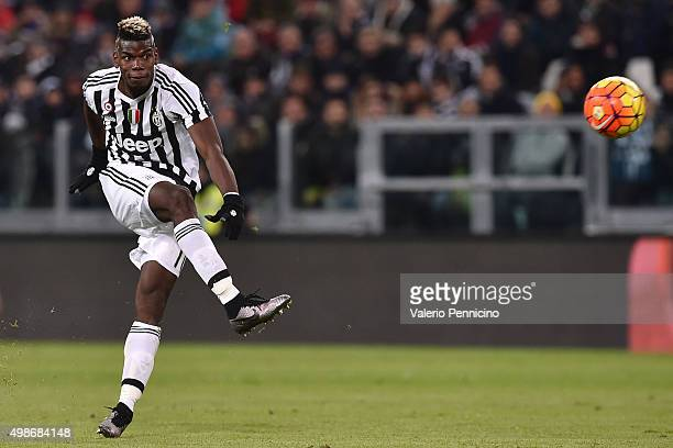 Paul Pogba of Juventus FC kiks the ball during the Serie A match between Juventus FC and AC Milan at Juventus Arena on November 21 2015 in Turin Italy