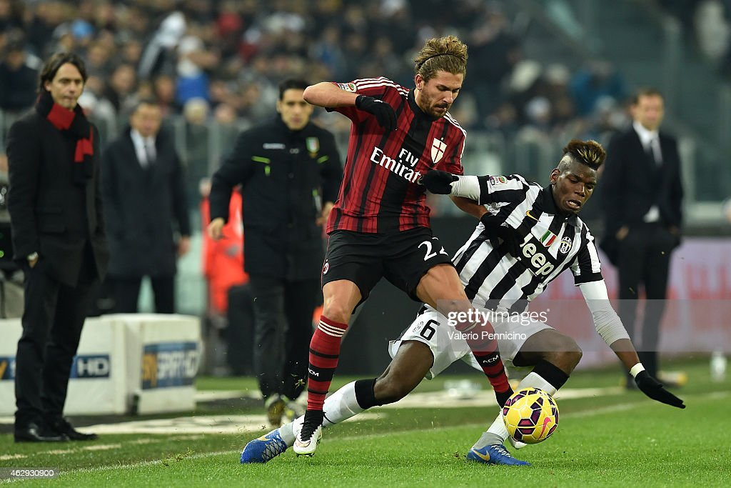 Paul Pogba (R) of Juventus FC tackles Alessio Cerci of AC Milan during the Serie A match between Juventus FC and AC Milan at Juventus Arena on February 7, 2015 in Turin, Italy.