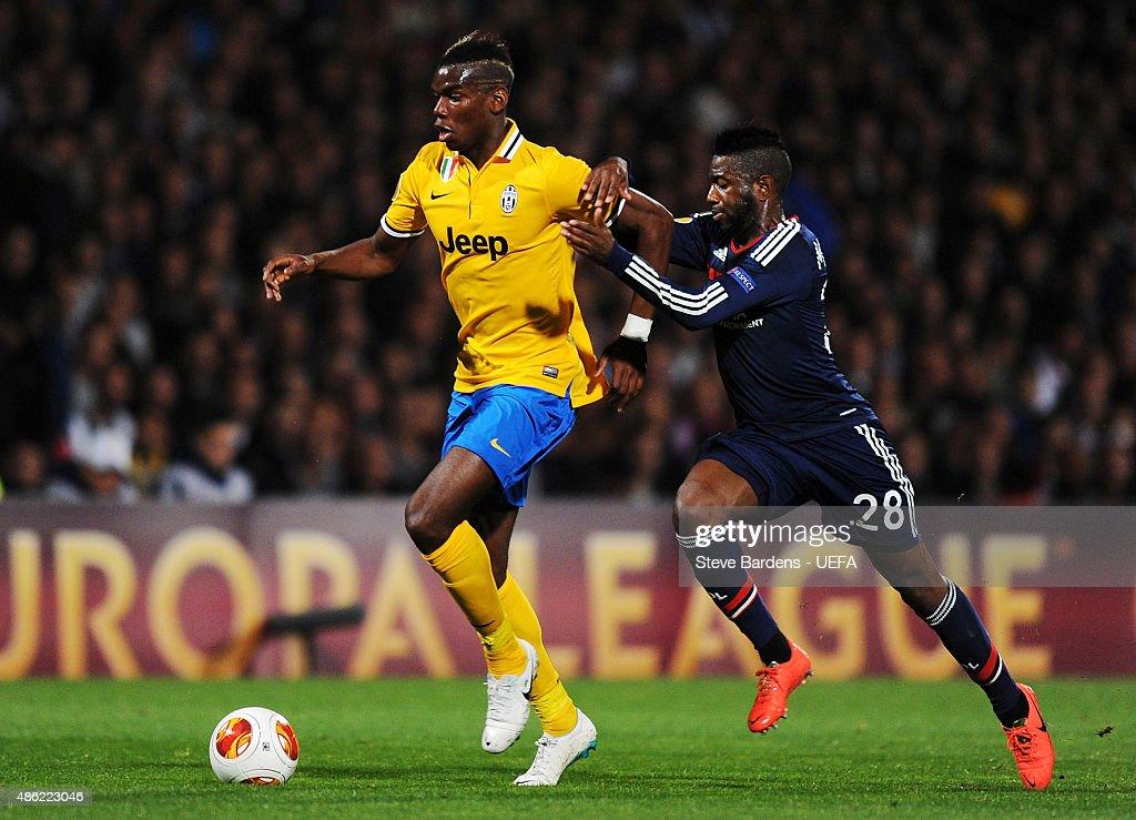 Paul Pogba of Juventus holds off Arnold Mvuemba of Olympique Lyonnais during the UEFA Europa League Quarter Final 1st leg match between Olympique Lyonnais and Juventus at Stade de Gerland on April 3, 2014 in Lyon, France.