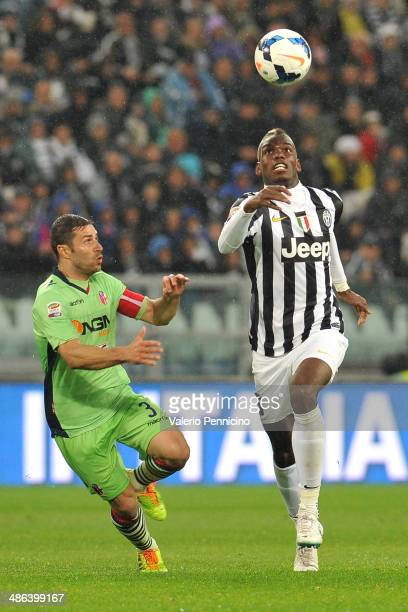 Paul Pogba of Juventus in action against Archimede Morleo of Bologna FC during the Serie A match between Juventus and Bologna FC at Juventus Arena on...