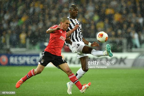 Paul Pogba of Juventus is challenged by Maxi Pereira of SL Benfica during the UEFA Europa League semifinal second leg match between Juventus and SL...