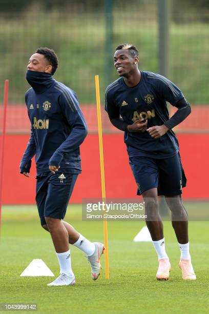 Paul Pogba of Man Utd and Anthony Martial of Man Utd in action during a training session ahead of their UEFA Champions League Group H match against...