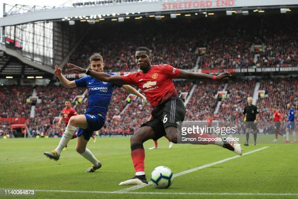 Paul Pogba of Man Utd battles with Jorginho of Chelsea during the Premier League match between Manchester United and Chelsea at Old Trafford on April...