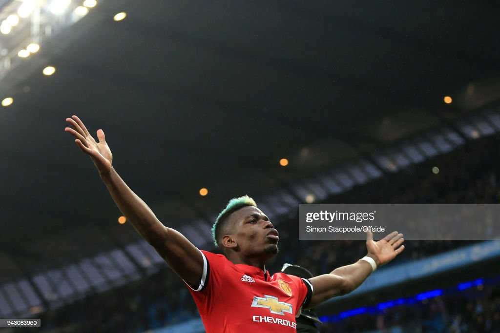 Paul Pogba of Man Utd celebrates victory at the end of the Premier League match between Manchester City and Manchester United at the Etihad Stadium on April 7, 2018 in Manchester, England.