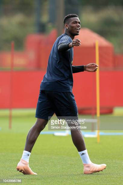 Paul Pogba of Man Utd gestures during a training session ahead of their UEFA Champions League Group H match against Valencia at the Aon Training...