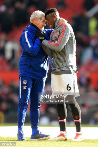 Paul Pogba of Man Utd greets Chelsea Fitness Coach Paulo Bertelli before the Premier League match between Manchester United and Chelsea at Old...